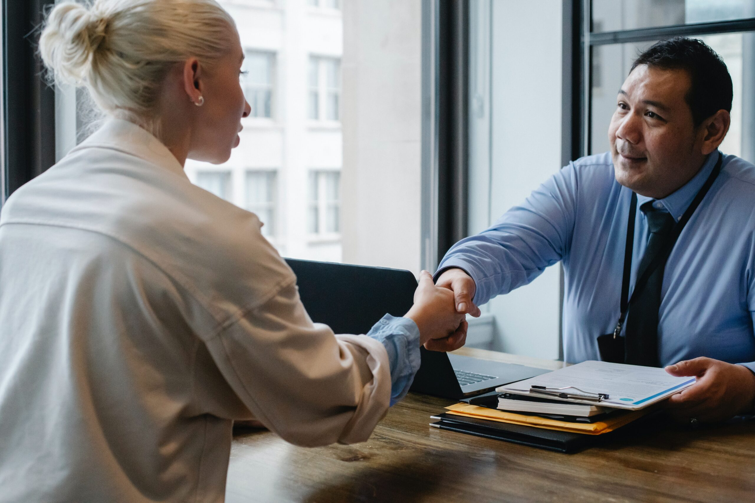 Business clients shaking hands
